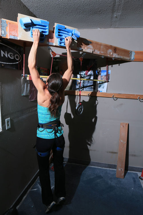 A pulley system, like The Rock Prodigy Pulley Kit, is essential for effective hangboard training.
